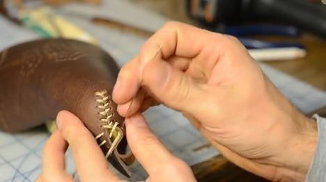 Carson Leh hand-stitching one of his custom designed bike saddles.
