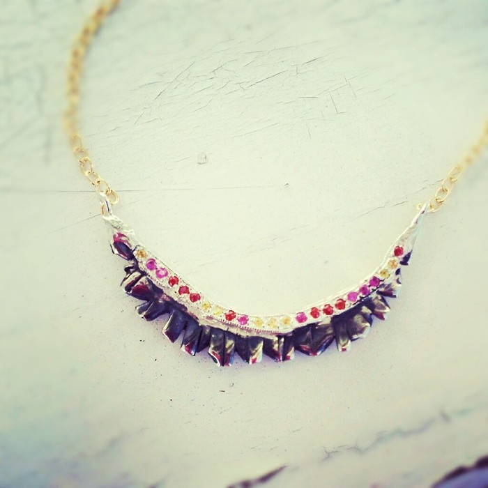 Magical Light Necklace - Sterling silver encrusted with multi-color sapphires and gold filled chain. Pledge at $375, $850 level
