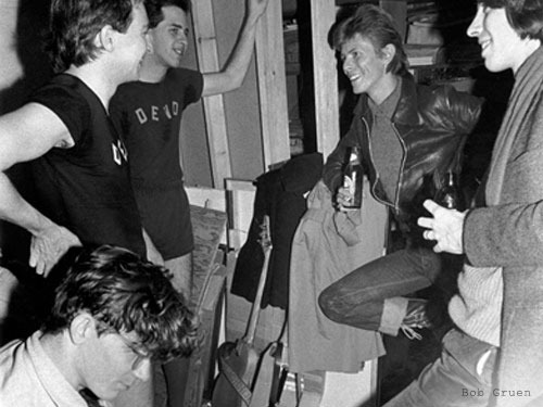 ABOVE: David Bowie with DEVO, backstage in NYC, 1977