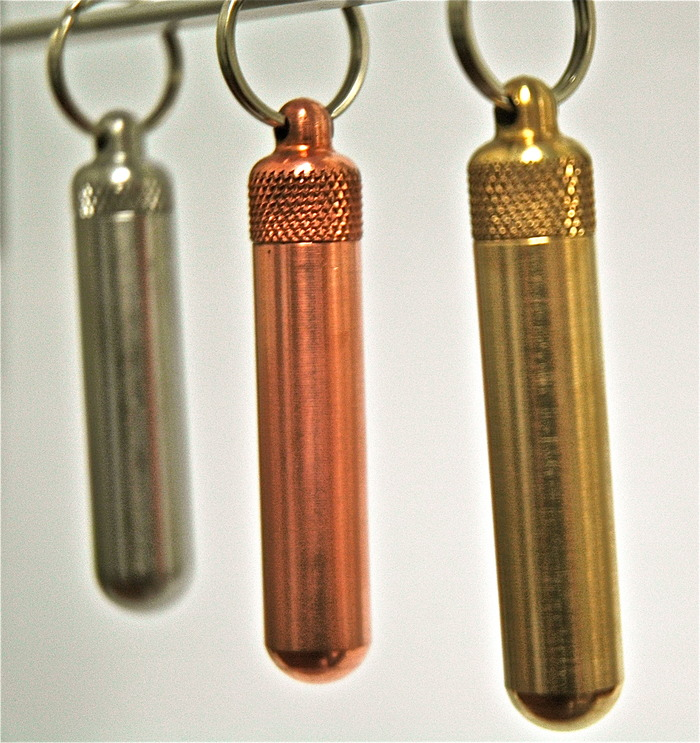 (from left to right) stainless steel, copper, and brass.