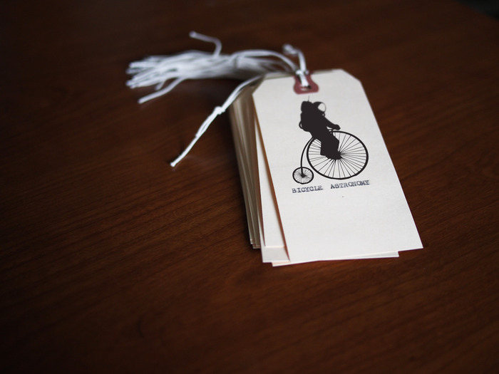 "Bicycle Astronomy ""Astronaut on a Pennyfarthing"" booksmarks, hand stamped and typed on a 1948 Corona Sterling."