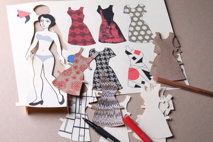 $25-- Constrvct Paper Doll set. A print with designs inspired by Constructivist art, plus a whole stack of pre-cut paper dresses for you to draw on, in kraft paper and tag board.