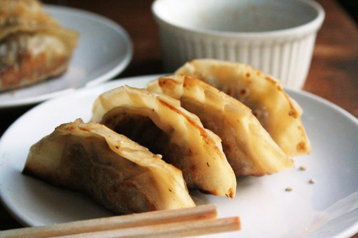 Black bean and kimchi dumplings with a tangy dipping sauce
