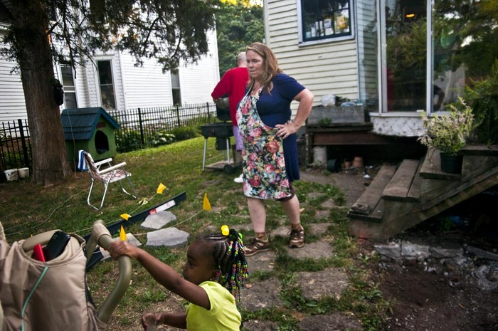 Sara Day watches her granddaughter Kamari in the backyard of her parents home in Midway, KY on the Fourth of July.