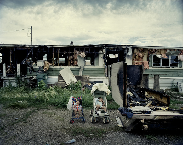 Adell White Dog's grandchildren sleep in strollers in front of the burnt trailer where they lived with Adell, their mother and aunt. PHOTO/JOAKIM ESKILDSEN