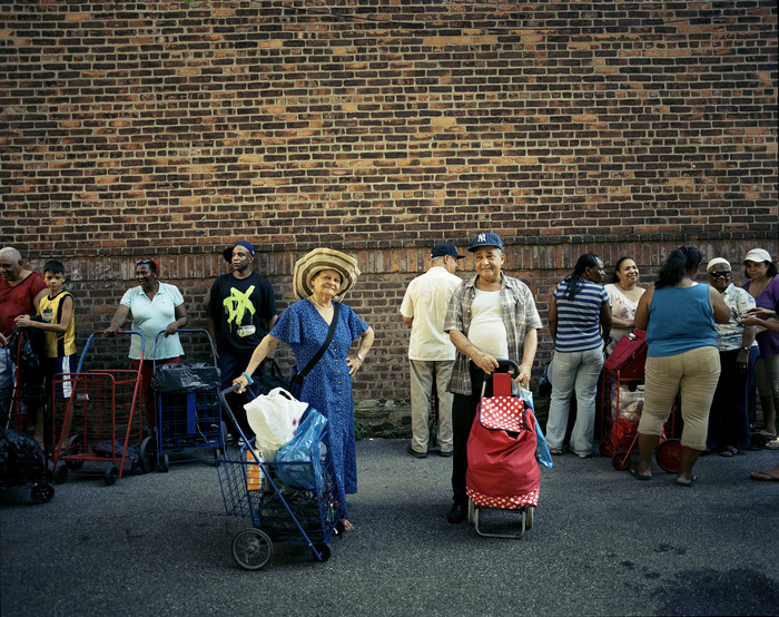 Bronx residents stand in line for free food.