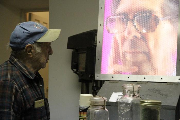 Robert Frank viewing giant Fly's Eye portrait of Count Roger de Montebello