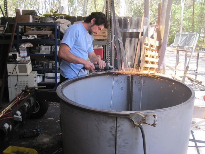 We're still making the big community prayer wheel! This photo shows Henry working on the bottom half of the wheel. It will be painted in a style similar to the hand and wind powered prayer wheels, but much more elaborate and decorative.