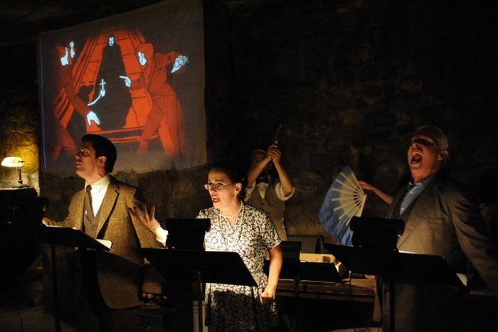 DRACULA - October 2010 - This show was a live radio-style performance in the stone walls of the Castle Theatre, with a foley stage (sound effects table) and original artwork projected throughout the show as our storyboard.