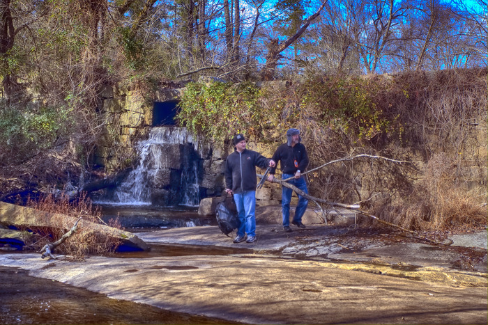 Some of these mill dams are tricky. We didn't find this one until I moved that big stick...with fellow photographer Eric Jones.