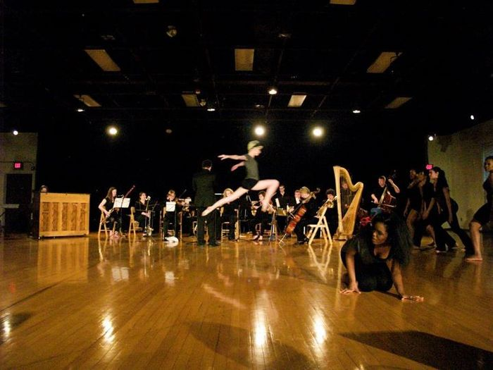 Chamber orchestra performs in a collaboration with dancers