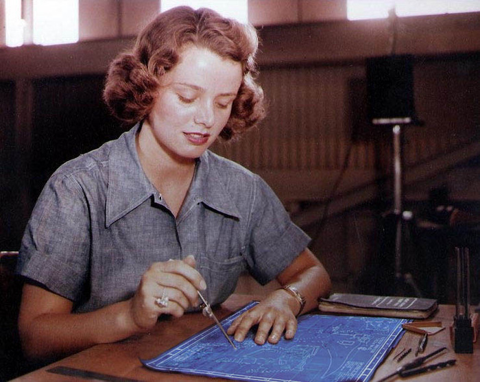 An unidentified woman working on the blueprints for Pvt. Vogel's backpack and field equipment.
