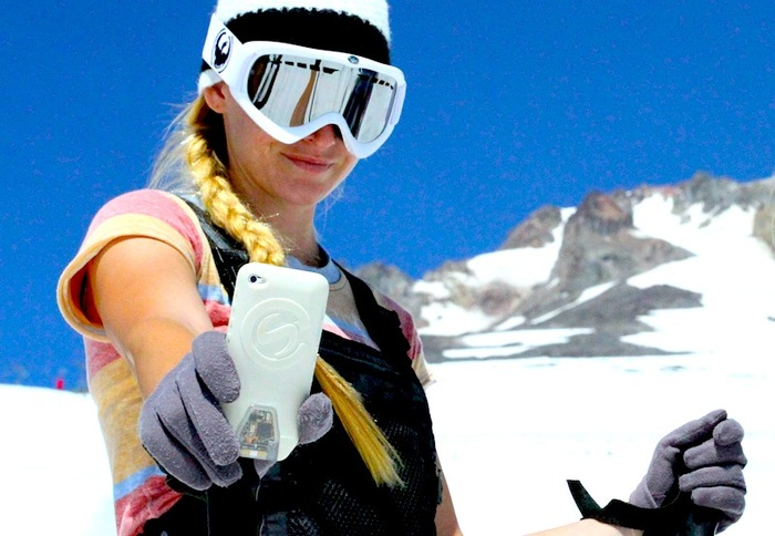 Sierra showing off her iPod XensrCase while ski testing up on Mt. Hood
