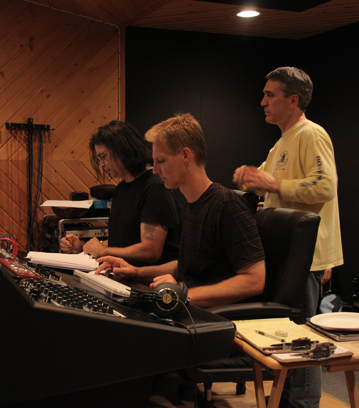 Jimmy Haslip, Paul Tavenner and Mitch Haupers listening to playback