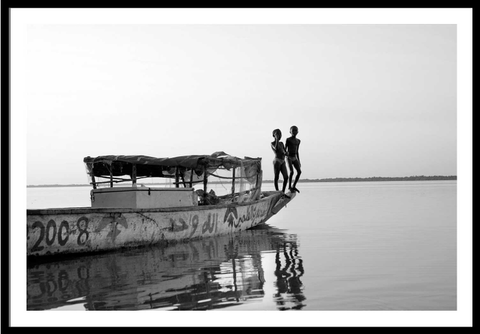 Boys playing on a boat on the River Gambia, The Gambia, West Africa © Jason Florio