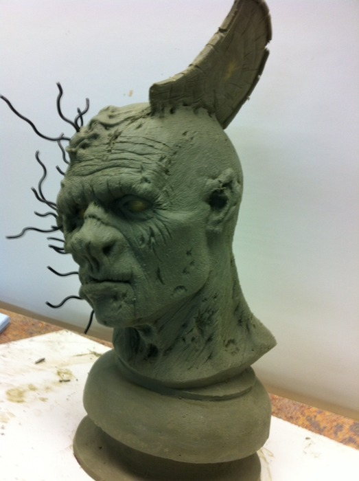 3/4 Profile shot of the Undead with the Z-Shield embedded in its skull.