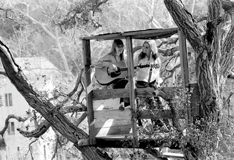 TWO SUPERSTARS IN A TREEHOUSE: Joni Mitchell and Judy Collins in Laurel Canyon 1969. Available with your donation.