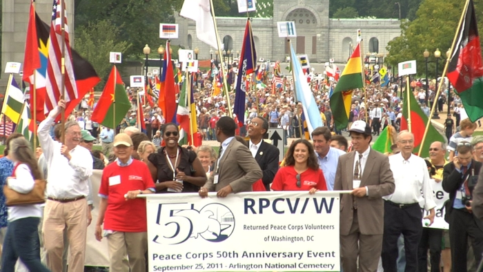 """Parade of Flags.  Returned Peace Corps Volunteers in """"EYE ON THE SIXTIES""""."""