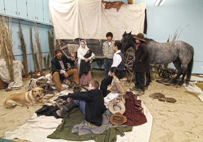 In the class room, yes that is a real horse and this is not a staged scenario.