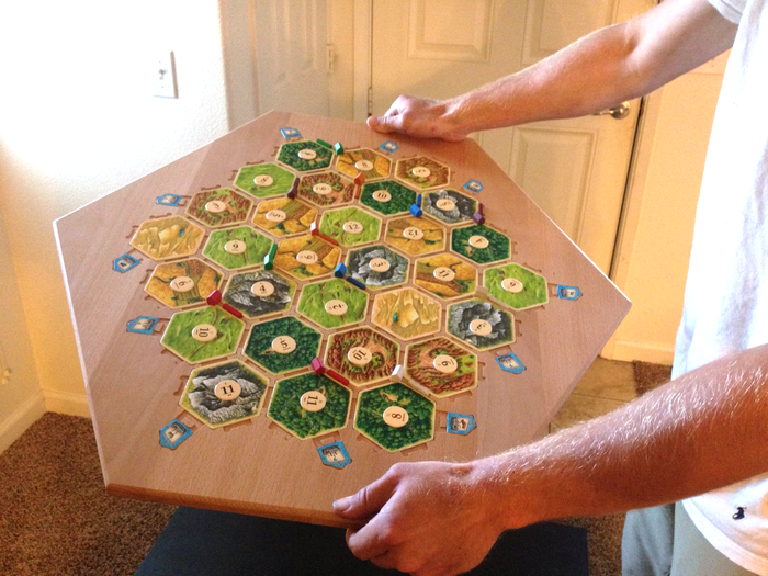 Like all the Catan Boards it holds the pieces quite securely for stability and simple movement to other locations.