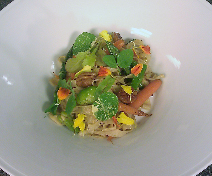 Fresh fettucini with local young vegetables, nasturtium leaves and pecans.
