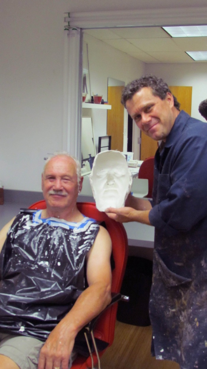 Jeff Buccacio holds up the negative/mold that shows details of Fred's face
