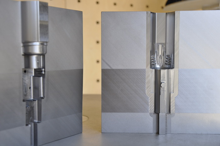 Hard tool steel mold for the light weight heatsink and light head. This tooling alone cost more than many new cars.