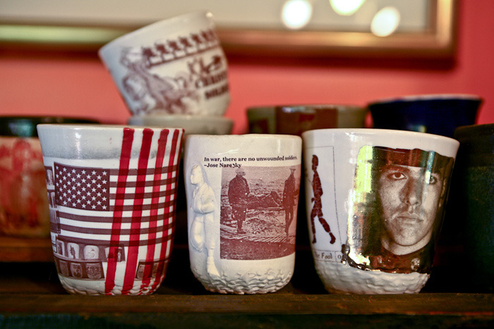 Ehren's ceramic cups with images from war stories.