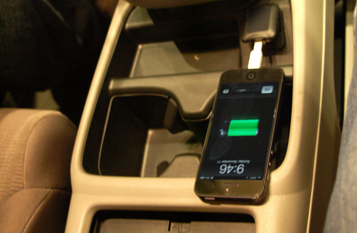 The Nomad charging from a USB port in a vehicle