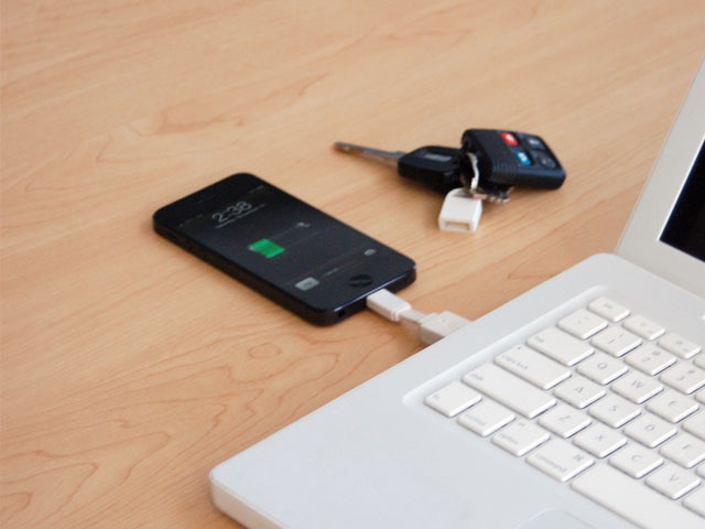The Nomad loves to nestle between your iPhone and laptop!