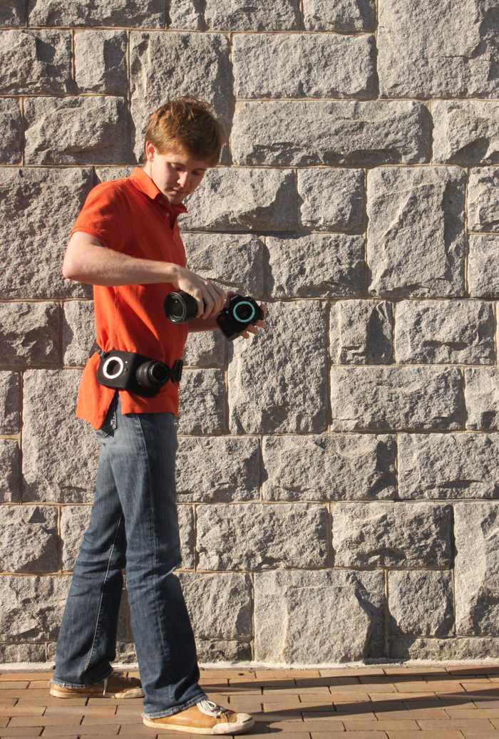 The Lens Holster can be worn around the waist...
