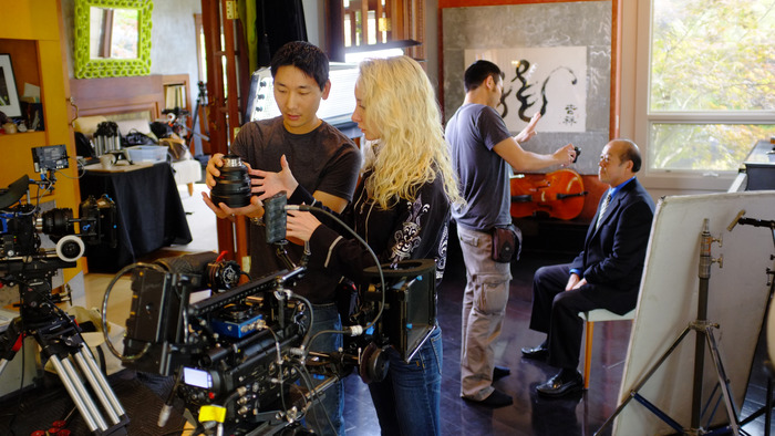 First AC Justin Jeung, Camera Assistant Cara Briese and Director of Photography David Y. Chung prepare cameras for an interview with PACO's Board Chairman Cary Chin.