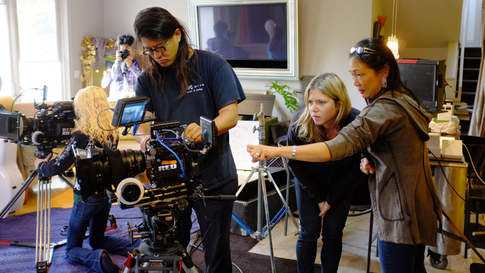 Digital Imaging Technician Stan Paik, Associate Producer Reba Rosenthal and PACO's Vae Sun prepare cameras.