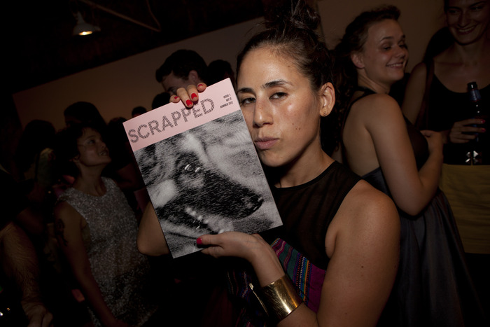 a fan with her copy at the Hit It launch party