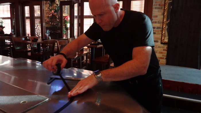 Applying Drink Runner's guide line to a bar top.