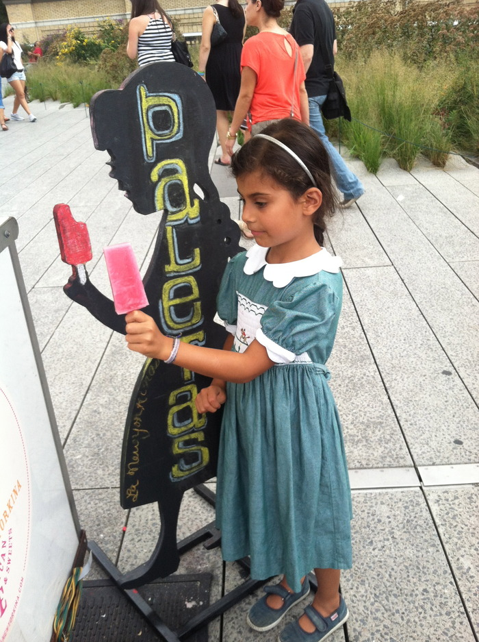 Little girl trying to mimic sillhouette of our flavor board with a (naturally) pink limeade