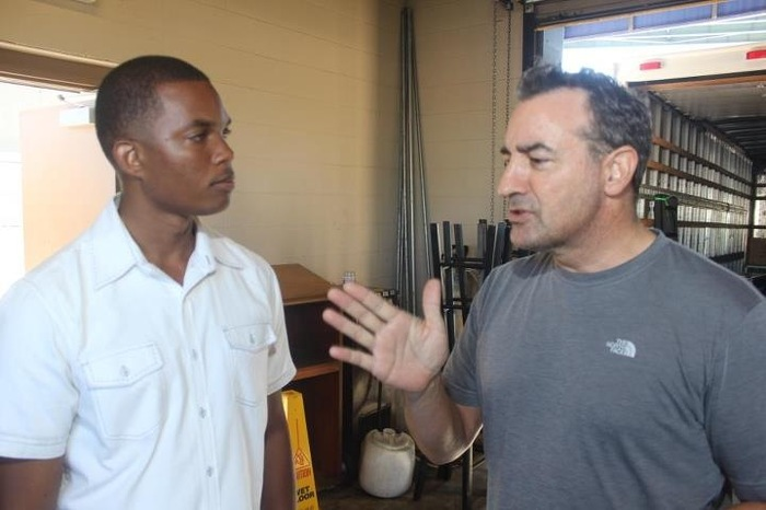 Jazz artists Kevin Hayden and Alex Bugnon chatting it up backstage after a show at African World Festival