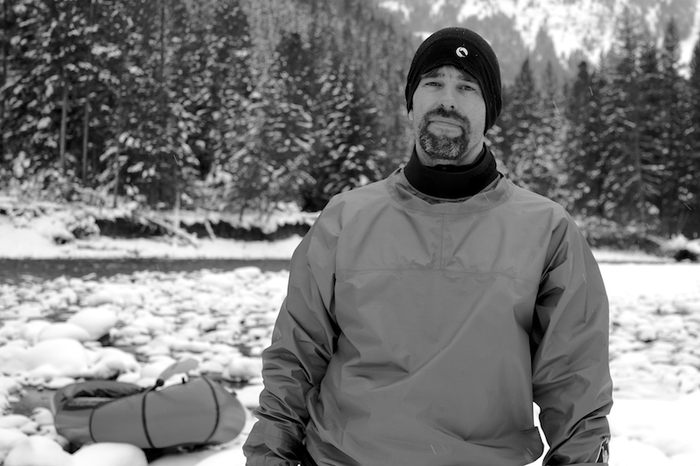 """Ryan at """"home"""" on Montana's Gallatin River, home of one of the state's finest technical packrafting runs - the """"Mad Mile""""."""