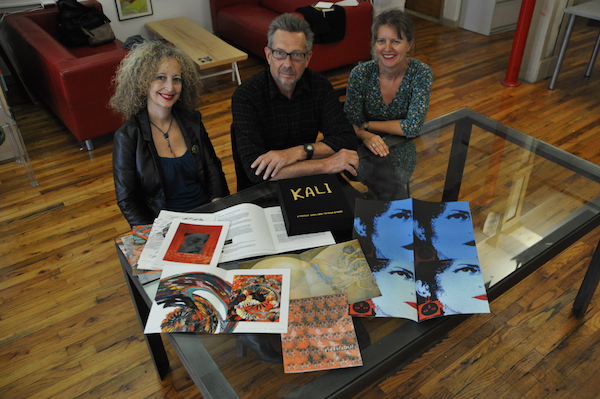 Seeking Kali Artist Collective signing their limited edition in the offices of Hyperallergic, Brooklyn, NY. Photo courtesy of Hrag Vartanian.