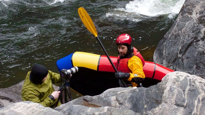 Sasha and Ryan shooting footage for Learn to Packraft! in Montana. Ya gotta love a DP who's standard clothing includes a dry suit.