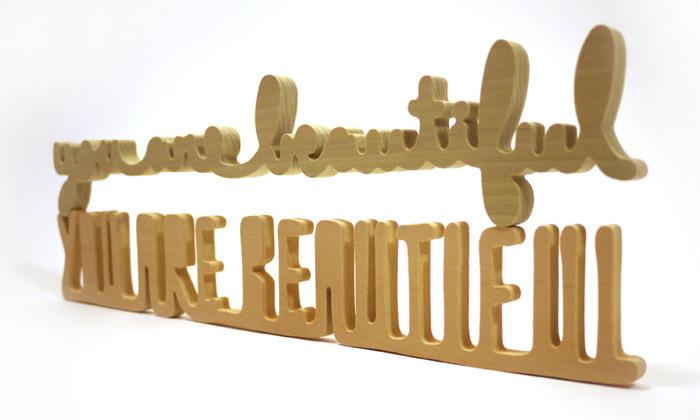 "Samples of hand cut wood edition (3"" x 18"") rewards - Cursive (top), All Caps (bottom)."
