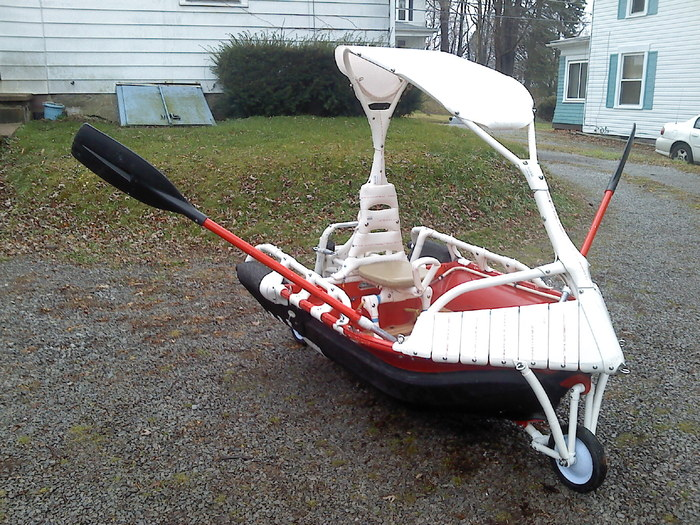 """I call this art work , """" Plastic pipe dream"""".  I really like how this hard top configuration handle's in and out of the water!  If you look closely, you will see a steering lever that folds down under the seat."""