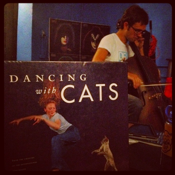 "rehearsing with Diego at the Jam Room Recording Studio...err I'm taking a break reading ""Dancing with Cats"" while Diego rehearses..."