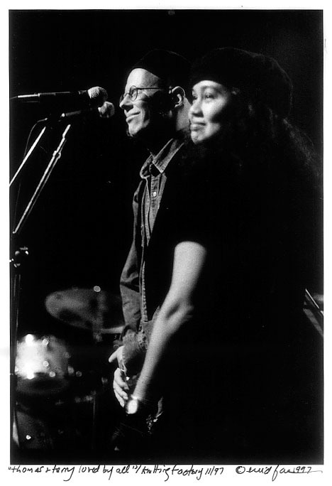 Photographer Enid Farber captured this poignant moment in 1997 at the Knitting Factory, on stage, of Thomas and Terri at a benefit concert held for him and attended by friends and fans.
