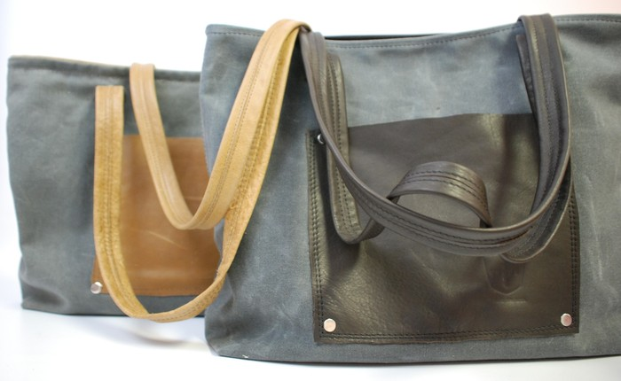 Waxed Canvas Totes, you pick canvas and leather trim. Bags shown are made with Charcoal Canvas and Walnut Leather (front) and Honey Leather (rear.) Retail Price $160