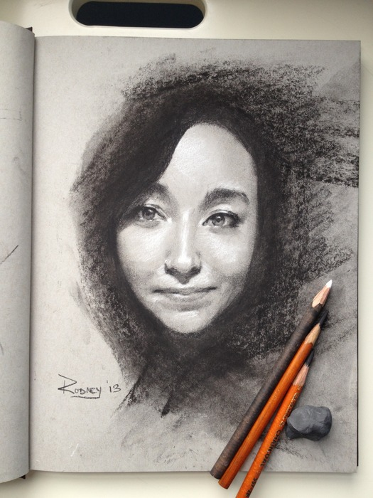 Sketch of Brianna with black and white charcoal.