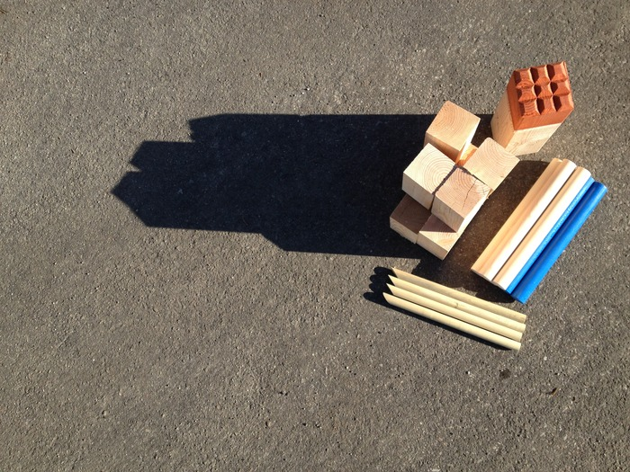 Each Kubb set includes: 1 redwood King, 10 pine kubbs, 4 stakes, and 6 batons
