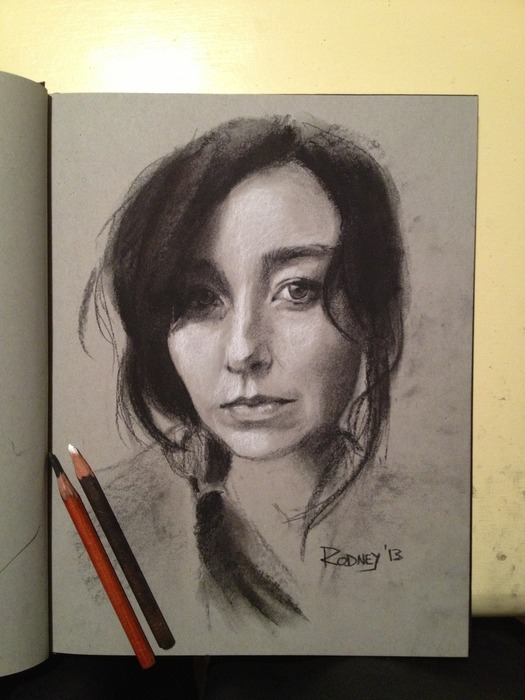 Sketch of Brianna with black and white charcoal on toned paper.