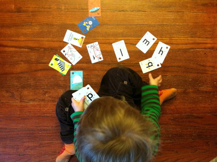 Silas playing with the Alphabet deck.