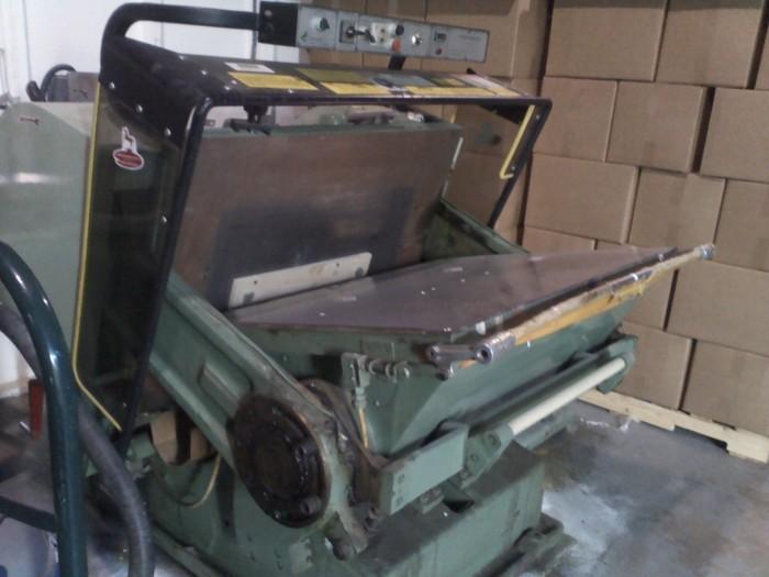 The die goes in this die cutting machine.